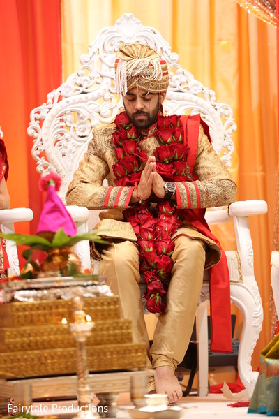 Indian groom praying during the wedding ceremony.