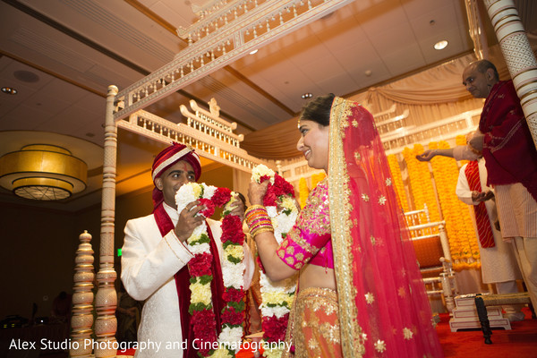 indian wedding ceremony,jaimala,floral and decor,indian bride and groom