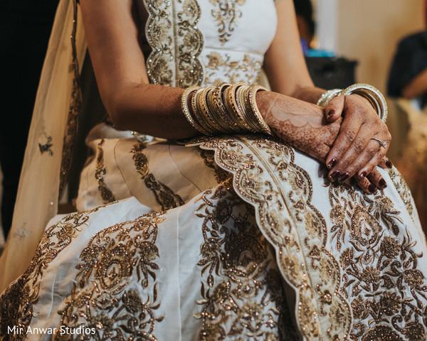 Gorgeous Indian bride white and gold lehenga.