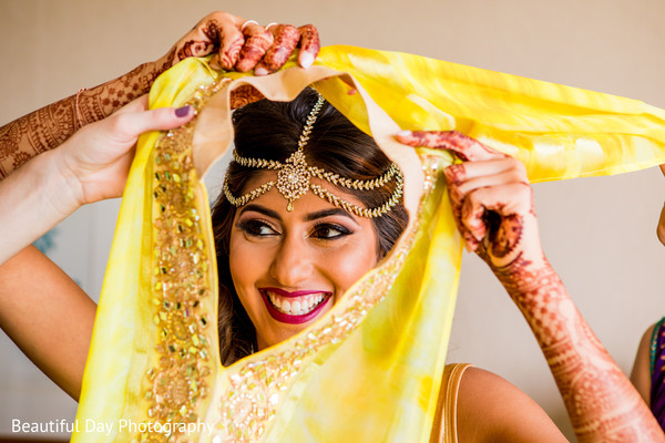 Gorgeous Indian bride getting ready.