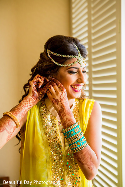 Lovely Indian bride yellow pre-wedding fashion.