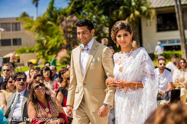 Indian couple walking down the isle.