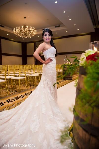 Indian bride in white wedding gown.
