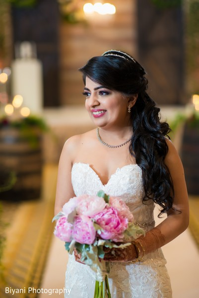 Gorgeous Indian bride in a classic white wedding dress.