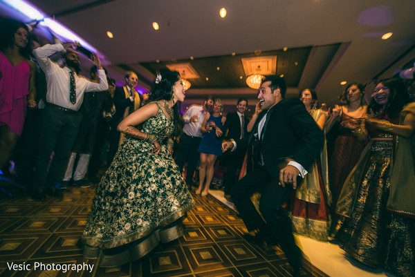Indian bride and groom showing off their moves