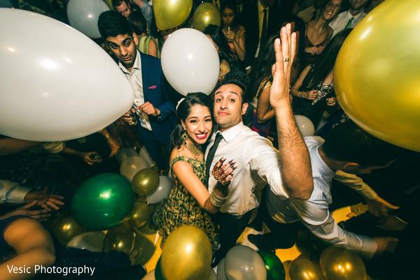 Indian newlyweds in the dance floor