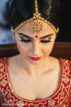 indian bride hair and makeup,bridal jewelry,bridal tikka