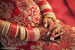 indian bride getting ready,bridal jewelry,maharani's bridal bangles,mehndi art