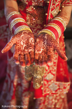 indian bride getting ready,bridal jewelry,indian bride,mehndi art