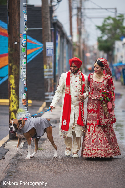 Cute indian couple walking with their dog