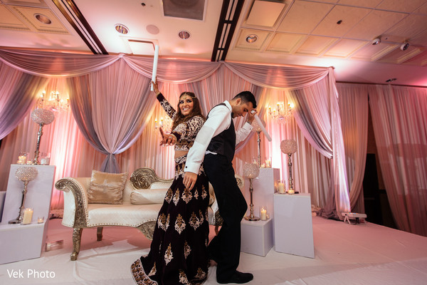 indian bride and groom,indian wedding reception,floral and decor