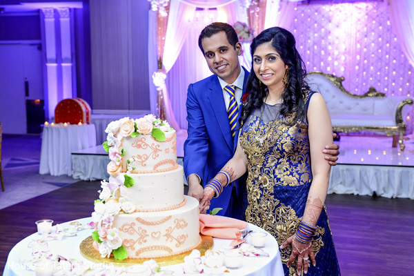 Indian wedding reception cutting the cake moment in Mahwah, NJ Indian Wedding by House of Talent Studio