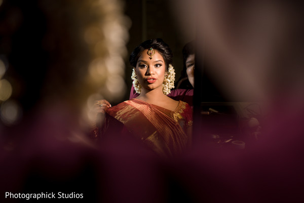 Take a look at this lovely indian bride getting ready in Alexandria, VA Fusion Indian Wedding by Photographick Studios