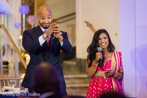 Indian bride and groom's wedding speech moment in Alexandria, VA Fusion Indian Wedding by Photographick Studios