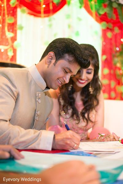 Indian bride and groom during engagement celebration