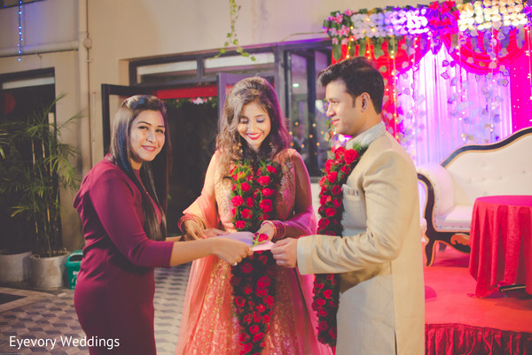 Adorable indian couple during their wedding engagement ceremony