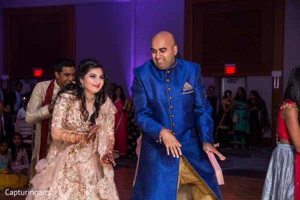 Dazzling indian couple dancing during wedding reception