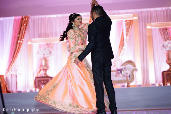 Indian bride and groom take their first dance.