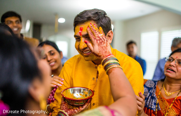 Indian Wedding Ritual Of Painting The Groom With Yellow Turmeric Paste In Savannah GA