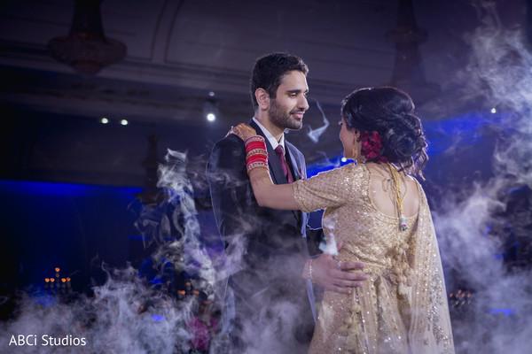 Beautiful Indian newlyweds dance.