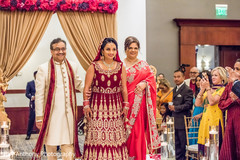 Dazzling indian bride walking down the aisle