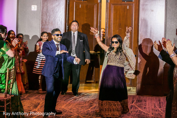 Indian lovebirds making their entrance to wedding reception