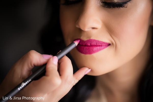 Indian bride makeup final touch ups.