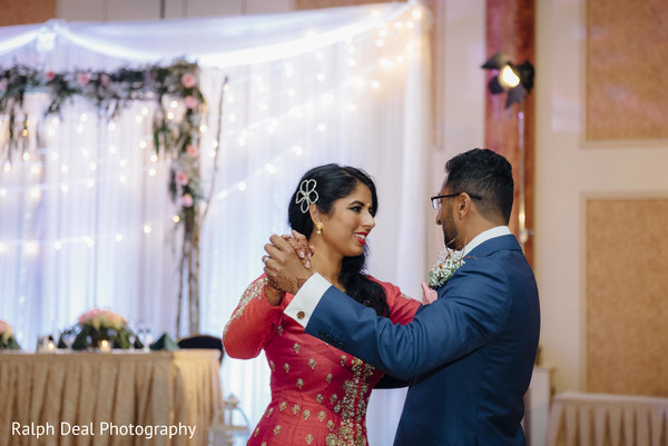 Adorable indian couple having their first dance