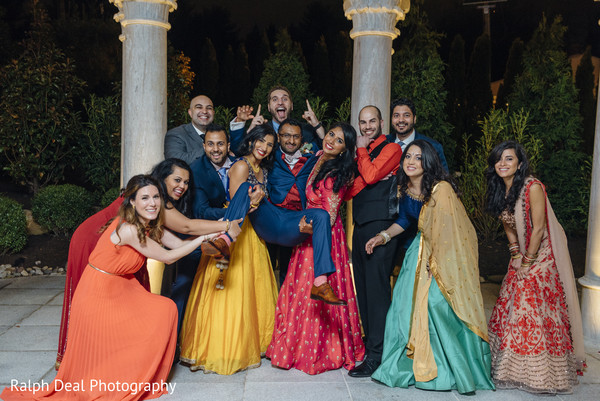 Vibrant indian bride and groom with bridesmaids and groomsmen photography