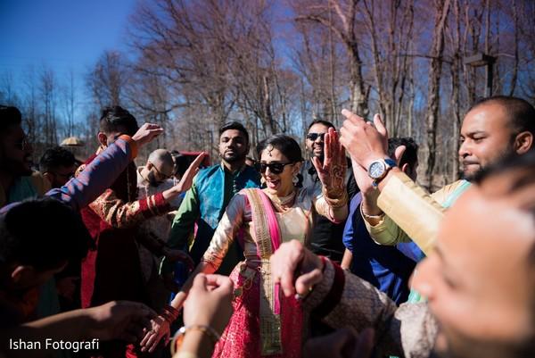 Guests dancing during baraat