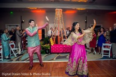 Indian bride and groom dancing