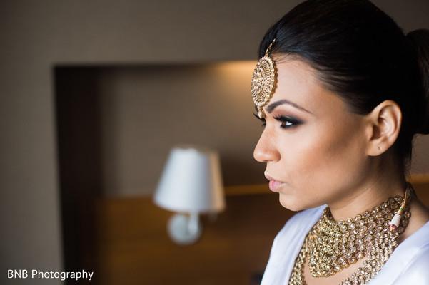 Beautiful indian bride getting ready