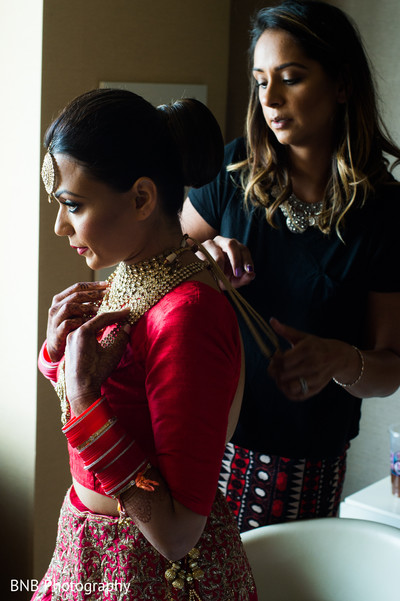 Indian bride getting ready capture