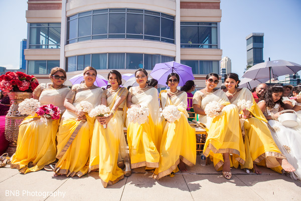 Lovely indian bridesmaids during wedding ceremomy