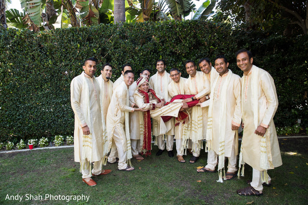 Indian groom posing with groomsmen