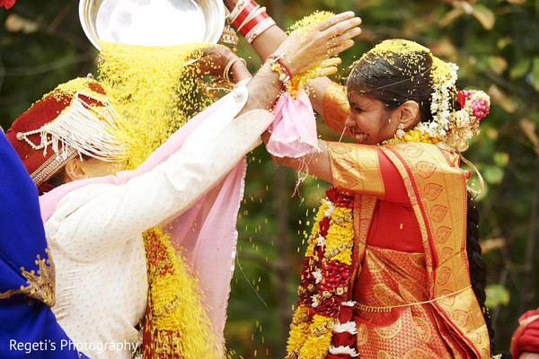 indian wedding ceremony,indian bride and groom,rice shower