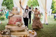 Glamorous indian bride and groom arriving at wedding reception