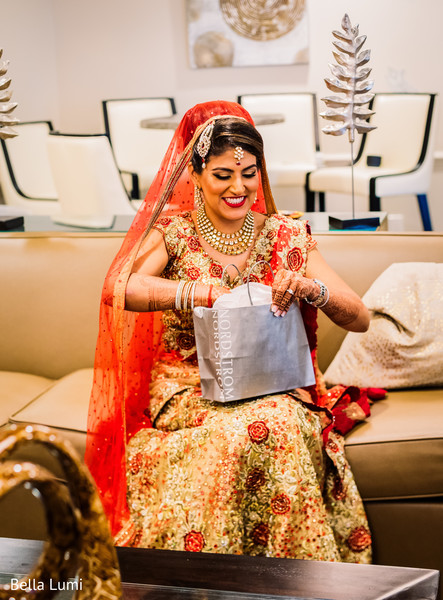 Adorable indian bride opening gift