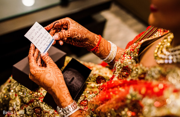 Sweet indian bride reading note from groom