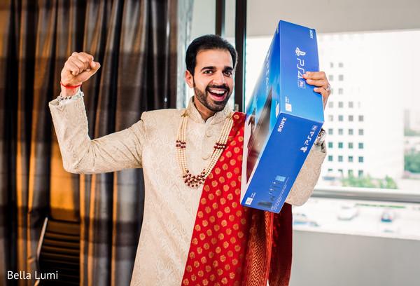 Joyful indian groom with pre-wedding gift