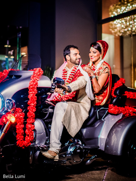 Indian bride and groom leaving wedding ceremony