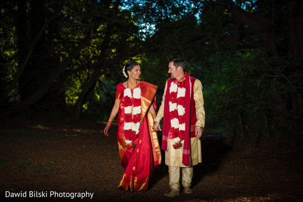 Sweet indian lovebirds walking holding hands