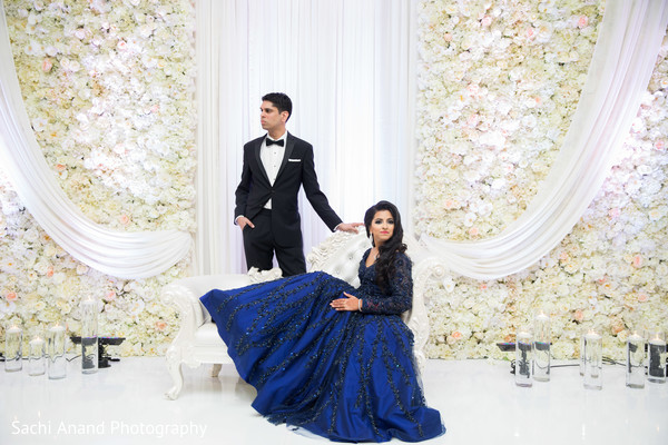 Glamorous indian bride and groom posing for photo shoot