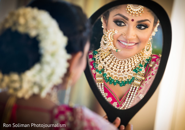 indian bride getting ready,bridal jewelry,bridal tikka,indian bridal makeup