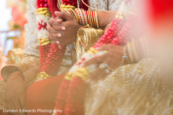Adorable indian couple holding hands close up