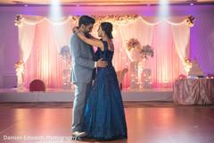 Indian bride and groom wedding reception dance.