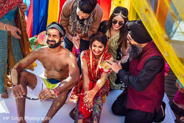 Indian Wedding Ritual Of Painting The Bride And Groom With Yellow Turmeric Paste In Puerto Vallarta