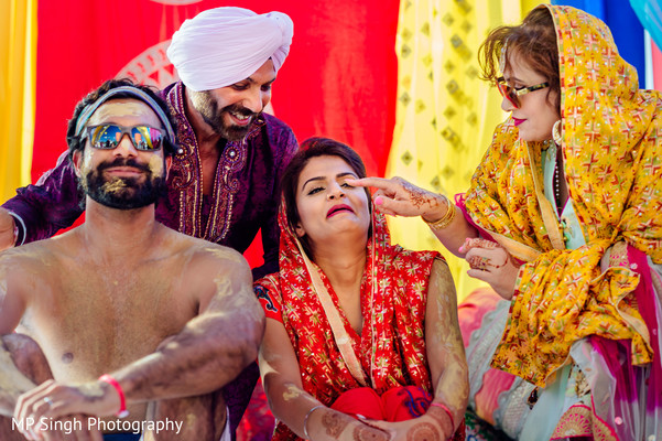 Indian Bride And Groom Are Smeared In Yellow Turmeric Paste At Their First Wedding Ceremony Ritual