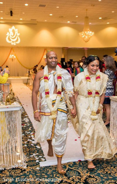 Adorable Indian  newlyweds  in their traditional wedding attires.
