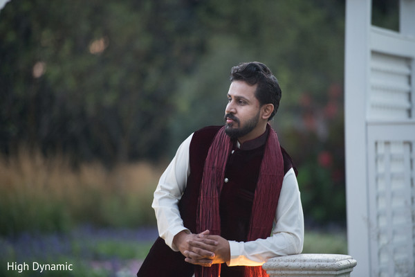 Elegant indian groom posing for photo shoot